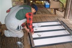 John-VE7DAY-working-on-solar-panels